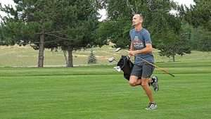 GOLFER, RICK AULIE, SETS SPEED RECORD